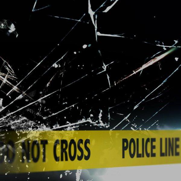 car crash carcked glass yellow tape _ ap image_304826