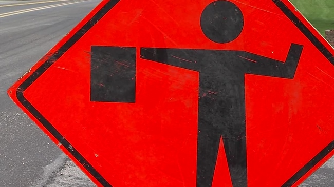 road_construction_flagger_sign_314008