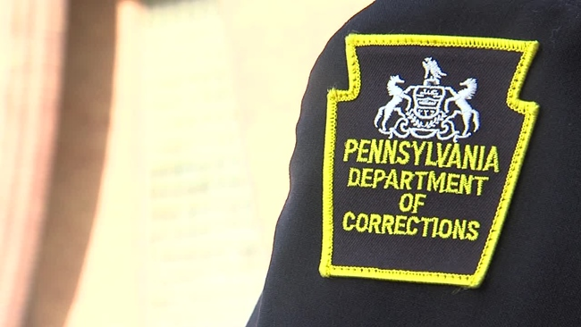 department_corrections_badge_1522079475019.jpg
