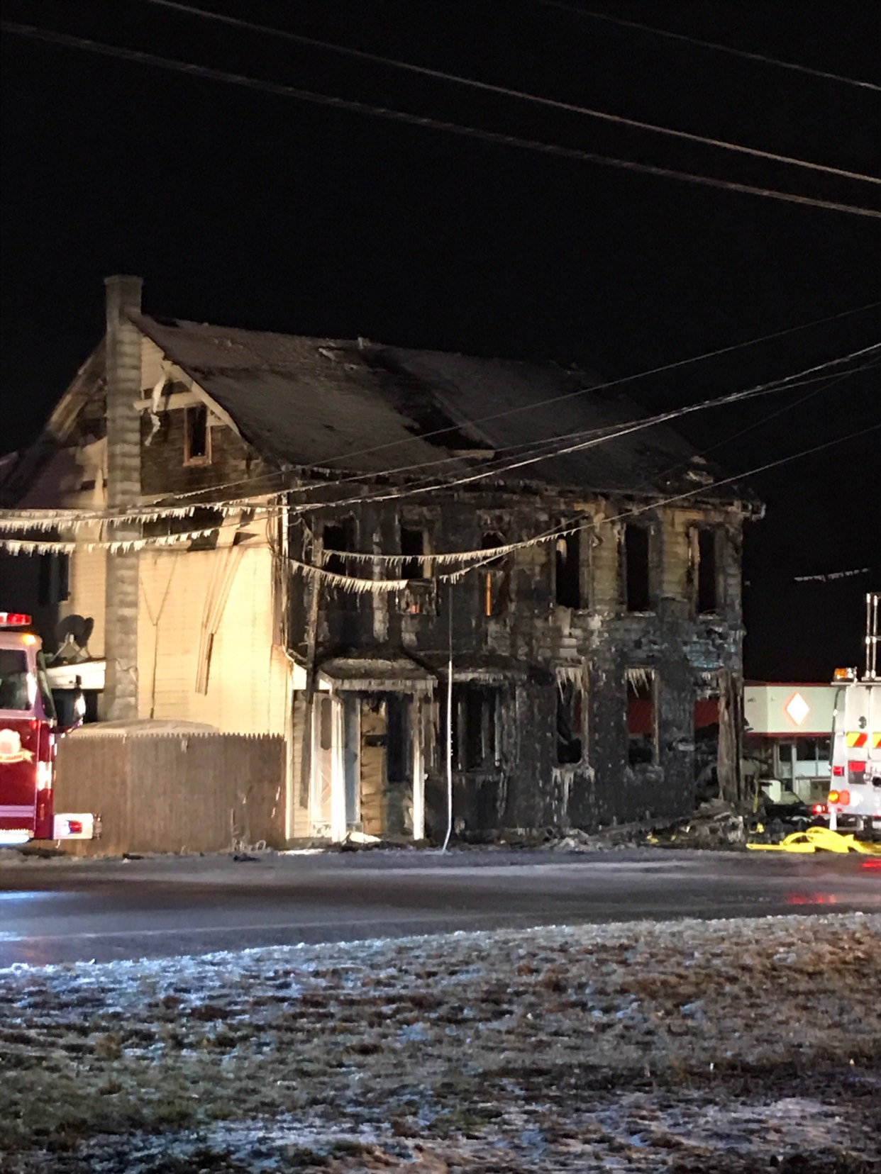 One dead after car crashes into home, sparks fire