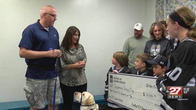 Hockey players raise thousands to provide service dogs to veterans