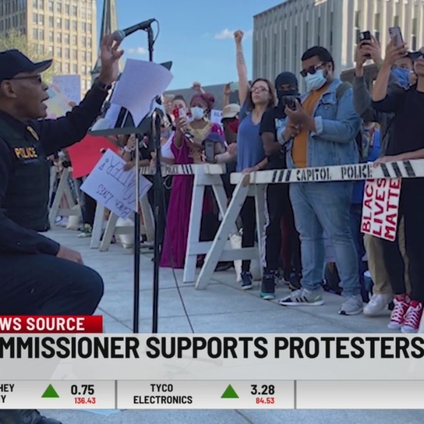 Harrisburg Police Commissioner Thomas Carter kneels before protesters June 1st on the Capitol steps, during a rally calling for justice in the death of George Floyd.