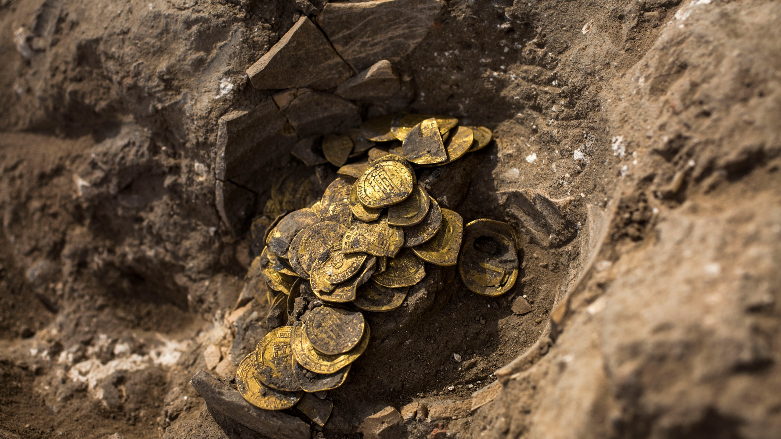 Trove Halloween 2020 Israeli dig unearths large trove of early Islamic gold coins | ABC27